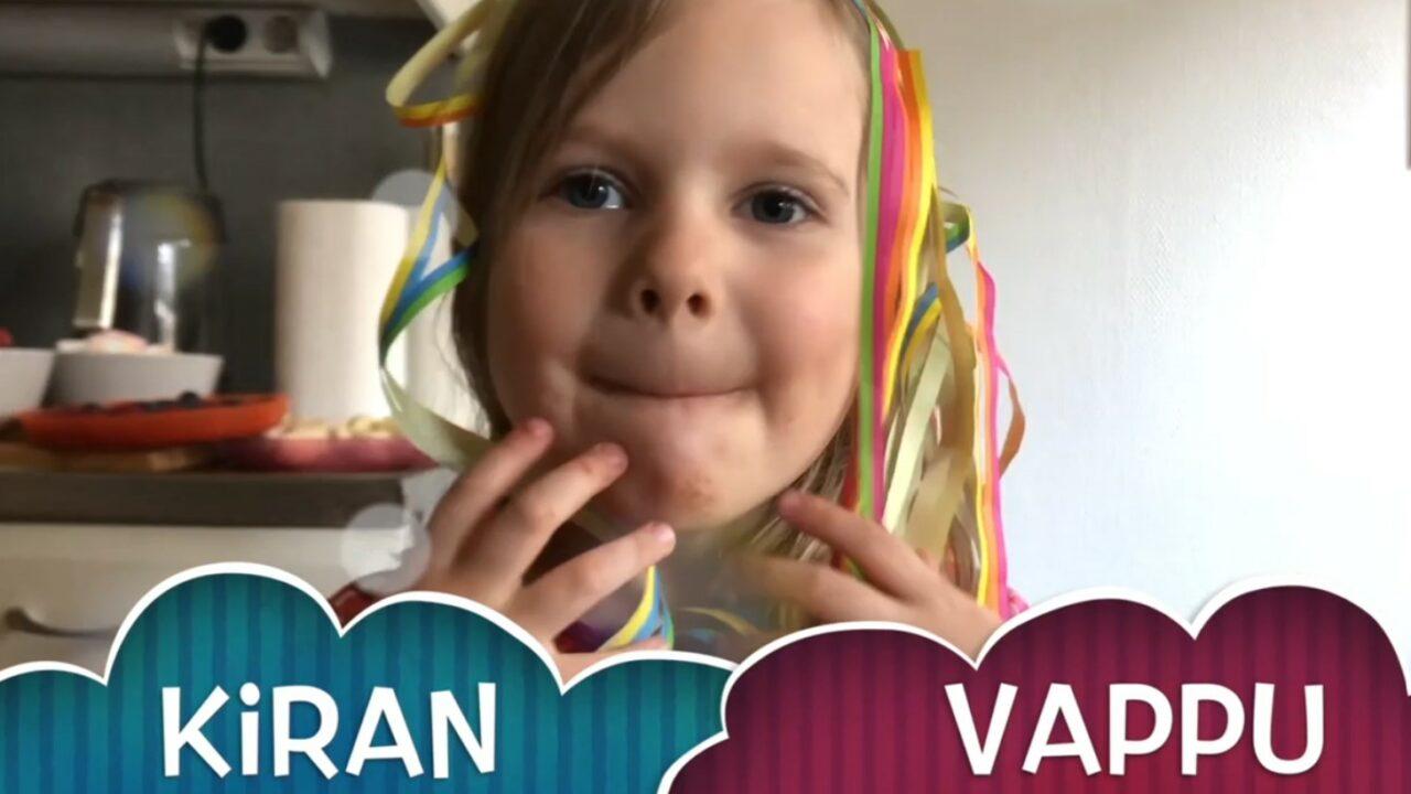 Pieni tyttö lähellä kameraan, päässä serpentiiniä ja alla videon nimi.