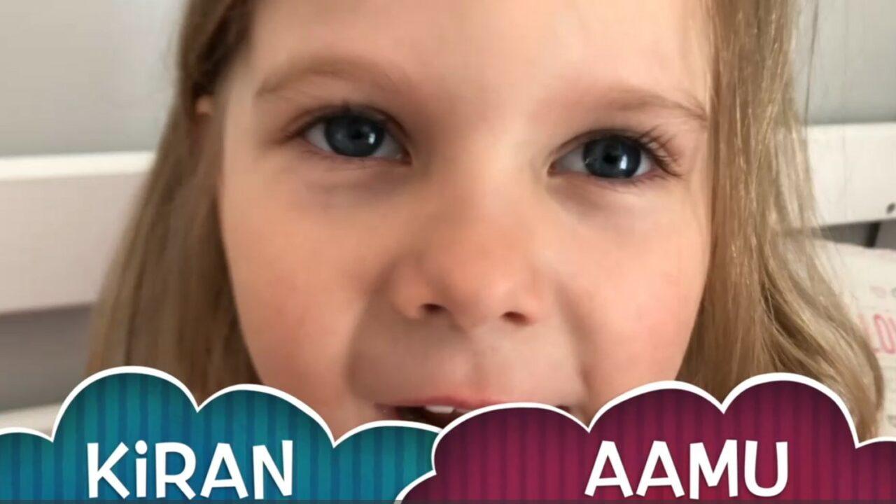 Pieni tyttö katsoo suoraan kameraan ja alareunassa on videon nimi.